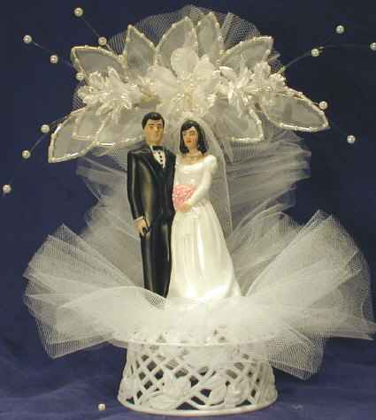 For those planning a theme wedding wedding cake toppers can augment the